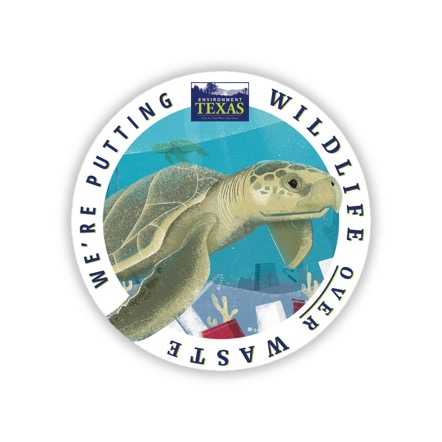 "A turtle in a circular sticker reading ""we're putting wildlife over waste"""