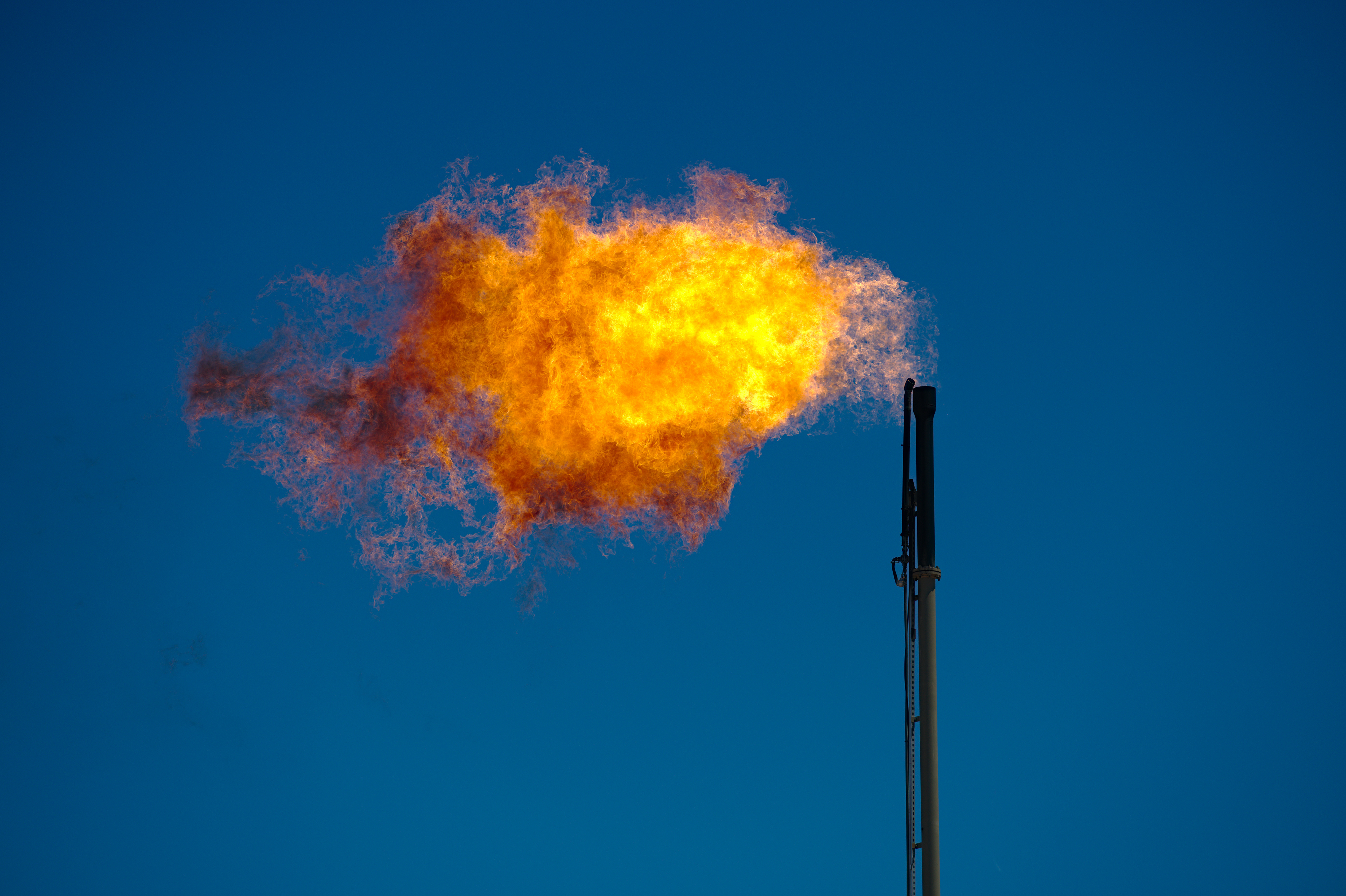 <h4>METHANE FLARES IN TEXAS</h4><h5>emitted over 13 million metric tons of global warming pollution in 2019 -- the carbon equivalent of 3.5 coal-powered power plants in a year.</h5><em>Shutterstock</em>