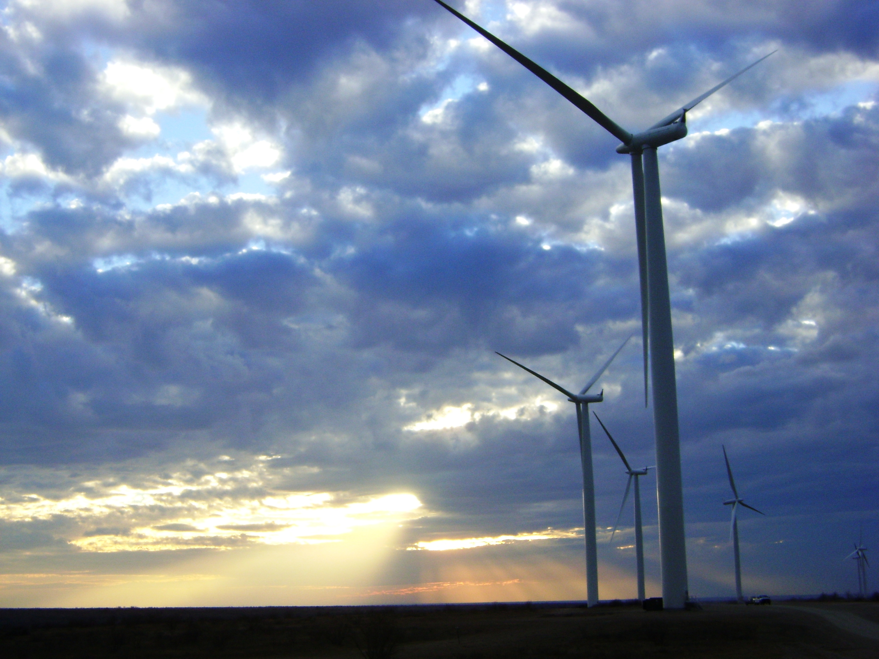 Sunset over Windmills on a field at the Hackberry windfarm in Texas