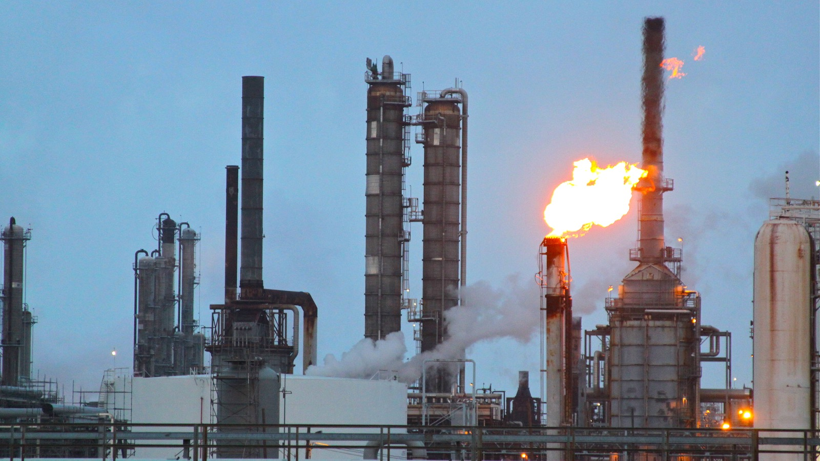 a flair burning bright over towers at Shell's Deer Park Refinery in Texas