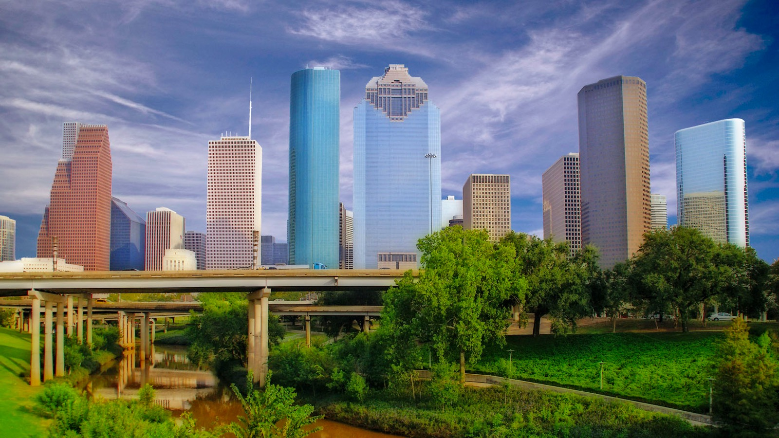 The Houston skyline behind Buffalo Bayou Park.